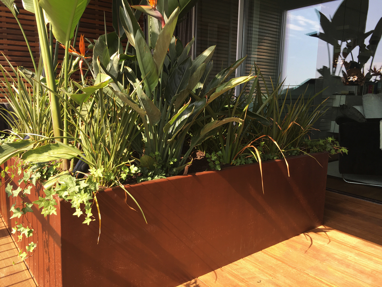 Terraza en Tiana por De Buena Planta